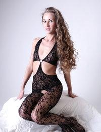 Blonde nympho Larisa looks overwhelming in her black fancy lingerie