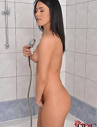 Babe Shoots Water Up Her Crack photo #2